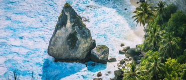 Close up of the Rock in Blue Ocean Foram near Atuh Beach, Nusa Penida, Bali Indonesia Royalty Free Stock Image