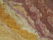 Close up of a rock in Ochre Pits. Ochre Pits a colourful outcrop of ochre on the banks of a sandy creek in the West MacDonnell Ranges in the northern Territories Stock Image
