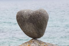 Close up of a rock in questionable equilibrium. On Uttakleiv Beach, a scenic beach near Leknes of the Lofoten Islands stock images
