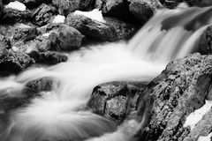 Close up of rock in river brook in satin soft water flowing  in long exposure Royalty Free Stock Photography