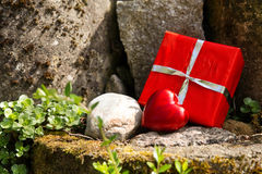 Close up of a rockery with a red heart and a gift Stock Photo