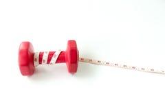 Close-up rode domoren met het meten van band rond rood hart Stock Foto