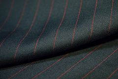 Close up role dark gray fabric of suit with red line strip. Photoshoot by depth of field for object royalty free stock photography