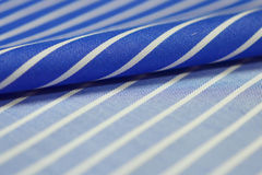 Close up roll blue and white fabric of shirt. Photo shoot by depth of field for object Stock Photos