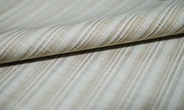Close up roll bright brown fabric of suit Royalty Free Stock Image