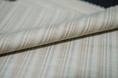 Close up roll bright brown fabric of suit Royalty Free Stock Images