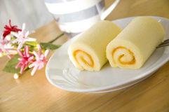 Close up roll cake. On table at noon Royalty Free Stock Photography