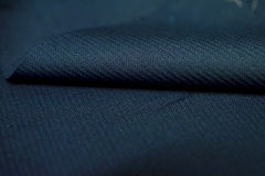 Close up roll dark blue stripe pattern texture of suit Royalty Free Stock Photos