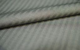 Close up roll gold fabric of suit. Photoshoot by depth of field for object Stock Photo