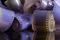 Close-up of a roll 35 mm photographic films. On a glass desk Stock Image
