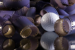 Close-up of a roll 35 mm photographic films. And golf ball Stock Images