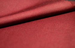 Close up roll red fabric of suit Stock Images
