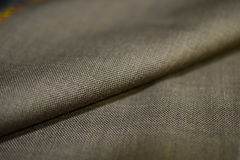 Close up roll stripe gold fabric of suit. Photo shoot by depth of field for object royalty free stock photography