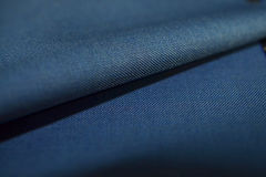Close up roll striped dark blue fabric of suit Royalty Free Stock Photo