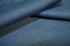 Close up roll texture denim blue fabric of suit Stock Images