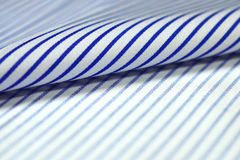 Close up roll thin blue line and white fabric of shirt Royalty Free Stock Photos