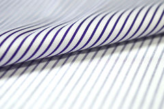 Close up roll thin purple line and white fabric of shirt. Photo shoot by depth of field for object Royalty Free Stock Photo