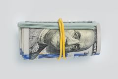Close-up rolled American dollars banknotes stock image