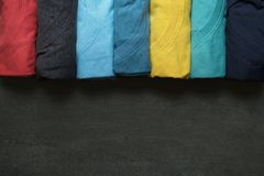 Close up of rolled colorful clothes on black background Royalty Free Stock Photography