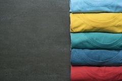 Close up of rolled colorful clothes on black background Stock Images