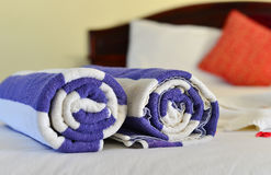 Close-up of rolled up blue bath towel. Close-up of rolled up bath towels on the bed at luxury resort in Phan Thiet, Vietnam Stock Images