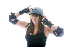 Close up roller derby girl. Female roller derby player on white background wearing protective gear Royalty Free Stock Photography