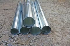 Rolls galvanized steel sheet in stacks on the ground,prepare for repair home stock photo