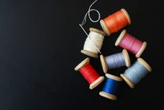 Close up Rolls of Vintage Colorful Threads. Clothes Repair, Black Dark Background. Sewing work process. copy Space. Close up Rolls of Vintage Colorful Threads royalty free stock photos