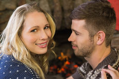 Close up of a romantic couple in front of fireplace Royalty Free Stock Photos