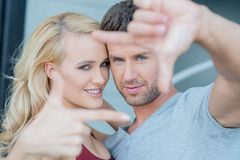 Close up Romantic Couple in Hand Frame Sign Stock Images