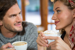 Close-up of romantic couple having coffee in cafeteria Stock Images