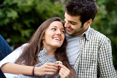 Close up of romantic couple in park. Stock Image