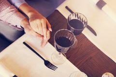 Couple eating romantic Dinner in a gourmet restaurant drinking wine and eating Stock Image