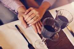 Couple eating romantic Dinner in a gourmet restaurant drinking wine and eating Royalty Free Stock Photos