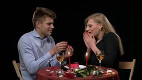 Close up of romantic dinner table with kissing stock video