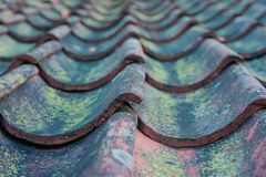 Roof tiles on old house closeups. Close-up of roof boilers on old house, pictures on time to renovate, companies selling home goods. Macro photo, color neutral royalty free stock photo