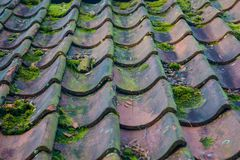 Roof tiles on old house closeups. Close-up of roof boilers on old house, pictures on time to renovate, companies selling home goods. Macro photo, color neutral royalty free stock images