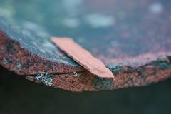 Roof tiles on old house closeups. Close-up of roof boilers on old house, pictures on time to renovate, companies selling home goods. Macro photo, color neutral stock photography