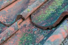 Roof tiles on old house closeups. Close-up of roof boilers on old house, pictures on time to renovate, companies selling home goods. Macro photo, color neutral stock images