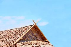Roof made from bamboo and dry leafs on sky background royalty free stock images