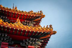 The close up of roof top of The Chinatown Gate at Yaowarat road in Bangkok, Thailand. stock photography