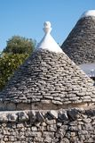 Cisternino. Close up of roof of traditional conical roofed Trullo house in the area of Cisternino / Alberobello in Puglia Italy royalty free stock photos