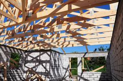 Roof trusses construction. Wooden Roof Frame House Construction. Roofing Construction. Royalty Free Stock Image