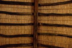 Close up of a roof with wooden beams. And wickers Stock Photography