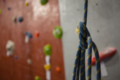 Close up of rope against climbing wall at gym Stock Photos