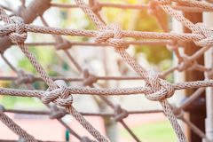 Close-up of rope knot line tied together. With playground background.selective focus Royalty Free Stock Photo