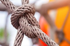 Close-up of rope knot line tied together. With playground background.selective focus Stock Image