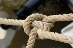 Close up of Rope for mooring a boat is adhered to a pier Royalty Free Stock Photo