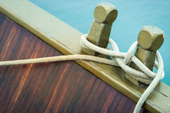 Close-up of rope with tied sea knot on ship deck. Stock Image