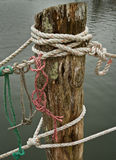 Close-up of ropes on a weathered dock. Stock Image